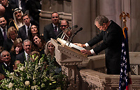 December 5, 2018 - Washington, DC, United States: Former U.S. President George W. Bush pauses for a moment while giving a eulogy during the state funeral service of his father, former President George W. Bush at the National Cathedral.  <br /> <br /> CAP/MPI/RS<br /> &copy;RS/MPI/Capital Pictures