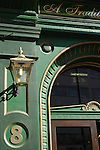 Close up of green exterior of the Garrick Arms traditional pub in Charing Cross Road, London, England