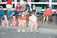 People watch the 4th of July parade in Amherst, New Hampshire, on Thu., July 4, 2019.