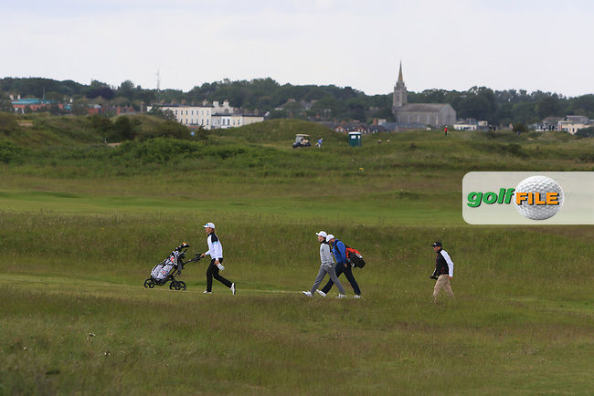 Conor Purcell (Portmarnock) walking down the 1st fairway during Round 1 of the The Amateur Championship 2019 at The Island Golf Club, Co. Dublin on Monday 17th June 2019.<br /> Picture:  Thos Caffrey / Golffile<br /> <br /> All photo usage must carry mandatory copyright credit (© Golffile | Thos Caffrey)