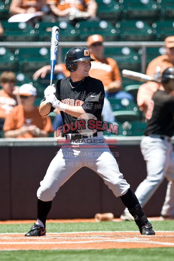 Oklahoma State catcher Kevin David bats against the Texas Longhorns on Sunday April 25th, 2010 at UFCU Dish-Falk Field in Austin, Texas.  (Photo by Andrew Woolley / Four Seam Images)