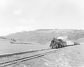 A very long mixed freight, eastbound, Los Pinos turn.  Lumber, oil, box, refers.<br /> Los Pinos, CO  Taken by Krause, John - 1952