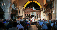 Seckou Keita from Senegal performing at St Mary's Church, Petworth Festival, West Sussex.