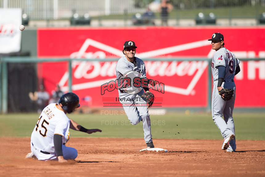 Glendale Desert Dogs shortstop Laz Rivera (8), of the Chicago White Sox organization, throws to first base for a double play as Will Craig (45) slides into second base and Yu Chang (9) looks on during an Arizona Fall League game against the Surprise Saguaros at Surprise Stadium on November 13, 2018 in Surprise, Arizona. Surprise defeated Glendale 9-2. (Zachary Lucy/Four Seam Images)