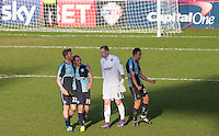 Jason McCarthy of Wycombe Wanderers congratulates goalscorer Michael Harriman of Wycombe Wanderers on the final whistle with Goalkeeper Ryan Allsop (Loanee from Bournemouth) of Wycombe Wanderers & Luke O'Nien of Wycombe Wanderers celebrating to the crowd during the Sky Bet League 2 match between Wycombe Wanderers and Mansfield Town at Adams Park, High Wycombe, England on 25 March 2016. Photo by Andy Rowland.