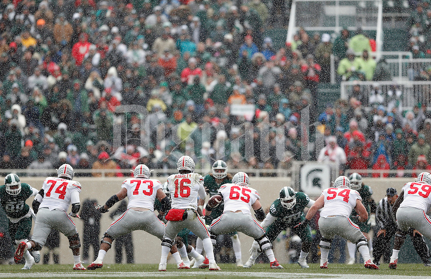 Ohio State Buckeyes takes on Michigan State Spartans in the snow during their game at Spartan Stadium in East Lansing, Michigan on November 19, 2016. (Kyle Robertson / The Columbus Dispatch)