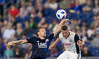 Foxborough, Massachusetts - August 11, 2018: In a Major League Soccer (MLS) match, Philadelphia Union (white) defeated New England Revolution (blue/white), 3-2, at Gillette Stadium.<br /> Penalty kick handball.