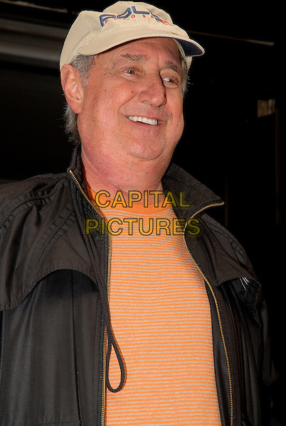 NEIL SEDAKA .Leaving Radio 2, London, England..June 12th, 2009.half length black jacket pink orange coral top white baseball cap hat .CAP/IA.©Ian Allis/Capital Pictures.