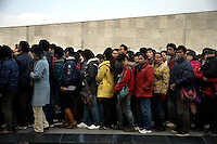 People line up to enter the Nanjing Massacre Memorial Museum in Nanjing, Jiangsu, China, on the 71st anniversary of the start of the Rape of Nanjing.