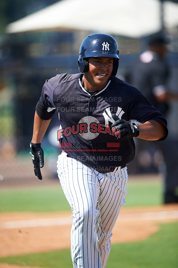 GCL Yankees East right fielder Lisandro Blanco (52) runs to first during a game against the GCL Yankees West on August 3, 2016 at the Yankees Complex in Tampa, Florida.  GCL Yankees East defeated GCL Yankees West 12-2.  (Mike Janes/Four Seam Images)