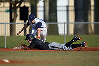 Lasell Lasers third baseman Tyler Flaherty (20) tags Casey Seelow (35) sliding into third base during the first game of a doubleheader against the Edgewood Eagles on March 14, 2016 at Terry Park in Fort Myers, Florida.  Edgewood defeated Lasell 9-7.  (Mike Janes/Four Seam Images)
