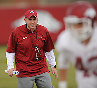 NWA Media/ANDY SHUPE - Arkansas' defensive coordinator Robb Smith directs his players during practice Saturday, Dec. 13, 2014, at the university's practice facility in Fayetteville.