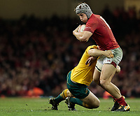 Wales' Jonathan Davies is tackled by Australia's Ben McCalman<br /> <br /> Photographer Simon King/CameraSport<br /> <br /> International Rugby Union - 2017 Under Armour Series Autumn Internationals - Wales v Australia - Saturday 11th November 2017 - Principality Stadium - Cardiff<br /> <br /> World Copyright &copy; 2017 CameraSport. All rights reserved. 43 Linden Ave. Countesthorpe. Leicester. England. LE8 5PG - Tel: +44 (0) 116 277 4147 - admin@camerasport.com - www.camerasport.com