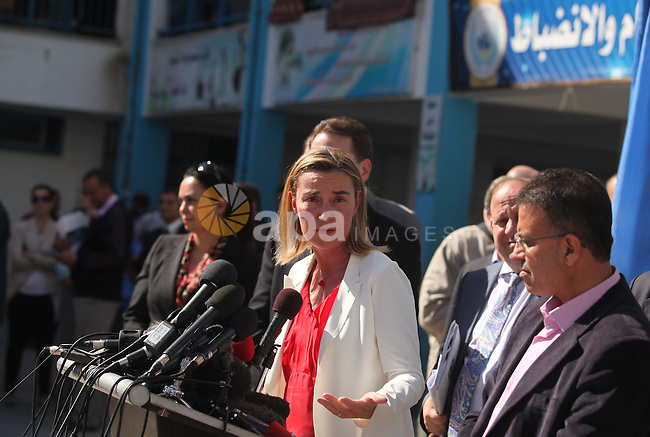 European Union foreign policy chief Federica Mogherini speaks during a press conference during her visiting a UN-run school sheltering Palestinians, whose houses were destroyed during the most recent conflict between Israel and Hamas, in Gaza City November 8, 2014. Photo by Ashraf Amra