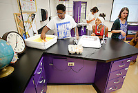 NWA Democrat-Gazette/DAVID GOTTSCHALK  Dennis McComb (left), a junior in the science class of Adaire Middleton at Agee Lierly Life Preparation, places eggs in an incubator Wednesday, August 26, 2015 on the campus in Fayetteville. Renovations work in the classrooms, bathrooms and hallway areas were ready for students returning to the alternative education center.