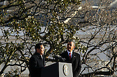 President Hu Jintao of China  (L) speaks as United States President Barack Obama (R) looks on during a state arrival ceremony at the South Lawn of the White House, Wednesday, January 19, 2011 in Washington, DC. Hu and President Obama will hold a press conference at the White House later today. .Credit: Alex Wong / Pool via CNP