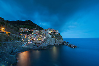 Manarola, Cinque Terre, Blue Hour Glow. The five villages of Cinque Terre are a World Heritage Site, for good reasons. Their history is long and colorful, and because of their pastel colors, they remain colorful today.