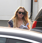 July 9th 2008.Lindsay lohan reading her movie script while .walking to her car in hollywood..Then using her movie script to.shield her face from the awesome Paparazzi.The name of the movie is Labor Pains...AbilityFilms@yahoo.com   805-427-3519.www.AbilityFilms.com
