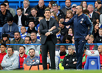 Chelsea Manager, Maurizio Sarri, makes a gesture to his team as Watford Manager, Javi Gracia looks on during Chelsea vs Watford, Premier League Football at Stamford Bridge on 5th May 2019