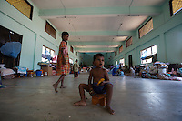 """A child, displaced by recernt bombings in his town, sits in the school where he is hosted together with other 400 families in Kinnyia, close to Trincomalee, in Eastern Sri Lanka on Sunday October 08 2006..hundreds of families from the island had to abbandone their homes when caught in the cross fire between LTTE forces and government  forces in early August. .The Sri Lanka civil war is an ongoing conf, The Sri Lanka civil was is an ongoing conflict on the island nation of Sri Lanka Since the 1983 """"Black July""""  pogrom there has been on and off civil war, mostly between the government and the Liberation Tigers of Tamil Eelam, or the LTTE, who want to create an independent state of Tamil Eelam in the north east of the island. It is estimated that the war has left 65000 people dead since 1983 and caused great harm to the population and economy of the country. A cease fire was declared in 2001, but hostilities renewed in late 2005. Following escalation of violence         in July 2006, a senior rebel leader declared the ceasefire null and void, although both sides later reaffirmed their commitment to the ceasefire agreement. Hundreds of people, including military personnel, rebels, and Tamil, Sinhalese and muslim civilians have been killed in fighting this year. Thousands of civilians have been displaced, many coming from areas already stroke by the dec 2004 Tsunami.."""