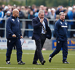 Ally McCoist scratching his chin as he walks off