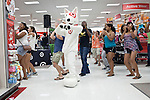 August 20, 2011. Chapel Hill, NC.. Bullseye, the Target mascot, dances to music played by a DJ for UNC students brought to the local Super Target by company chartered buses. Target hired the buses and staged sales to encourage students to buy items in the store that they might need for their dorm rooms.. Many companies have increased their efforts to reach the youth market by employing popular college students to raise the awareness of the brand by peer to peer marketing on campus' around the country.