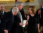 House Minority Leader Nancy Pelosi of Calif., right, talks with House Majority Leader Kevin McCarthy of Calif., center, and House Minority Whip Steny Hoyer, D-Md., left, as they arrive to attend services for former President George H.W. Bush is carried by joint services military honor guard into the Capitol in Washington, Monday, Dec. 3, 2018. (AP Photo/Pablo Martinez Monsivais/Pool)