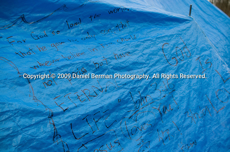 "New residents must stay one week in a large tent nicknamed the ""M.A.S.H tent"" which has been adorned with other resident's favorite Bible quotes. New residents receive their own tent the next week if they follow the camp rules: no fighting, drinking or drugging, stealing, or going in other people's tents.."