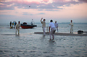 11/09/14 <br /> ***Caption Correction  - Cowes not Ryde as in previous****<br /> <br /> Rival teams from the Royal Southern Yacht Club and The Island Sailing Club compete in a game of cricket on the Brambles Bank sandbank at dawn. The sandy wicket only appears for a few minutes on the lowest tide of the year in the middle of the Solent between Cowes and Southampton.<br /> <br /> All Rights Reserved - F Stop Press.  www.fstoppress.com. Tel: +44 (0)1335 300098