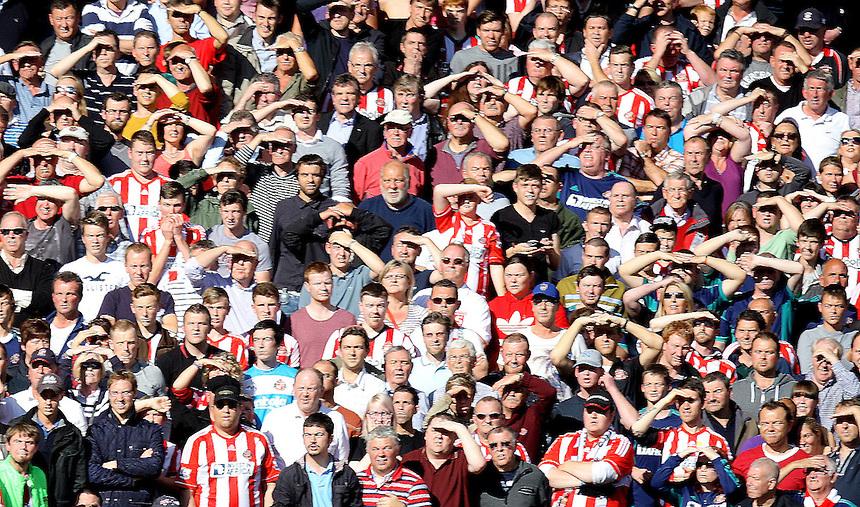 Sunderland fans shield their eyes from the sun..Football - Barclays Premiership - West Ham United v Sunderland - Saturday 22nd September 2012 - Boleyn Ground - London..
