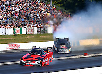 Jun. 1, 2014; Englishtown, NJ, USA; NHRA funny car driver Cruz Pedregon (left) alongside Terry Haddock during the Summernationals at Raceway Park. Mandatory Credit: Mark J. Rebilas-
