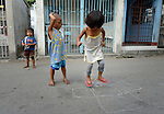"In the capital of the Philippines, children play in the Manila North Cemetery. Hundreds of poor families live here, dwelling in and between the tombs and mausoleums of the city's wealthy. They are often discriminated against, and many of their children don't go to school because they're too hungry to study and they're often called ""vampires"" by their classmates. With support from United Methodist Women, KKFI provides classroom education and meals to kids from the cemetery at a nearby United Methodist Church."