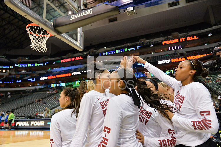 Dallas, TX - Friday March 31, 2017: Players huddle prior to the NCAA National Semifinal Game between the women's basketball teams of Stanford and South Carolina at the American Airlines Center.