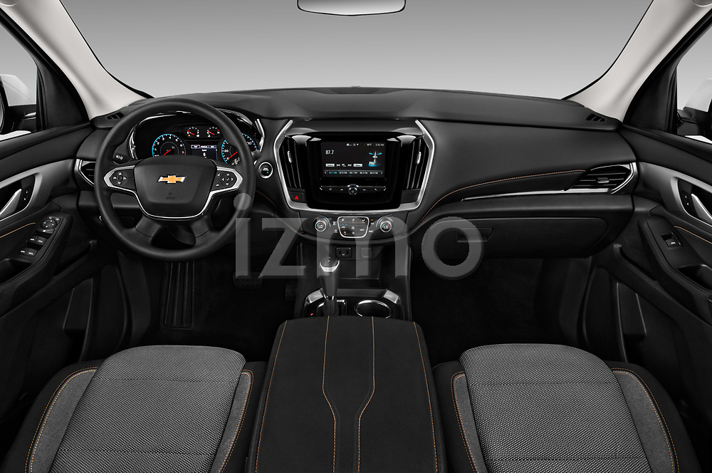 Stock photo of straight dashboard view of a 2018 Chevrolet Traverse LS 5 Door SUV