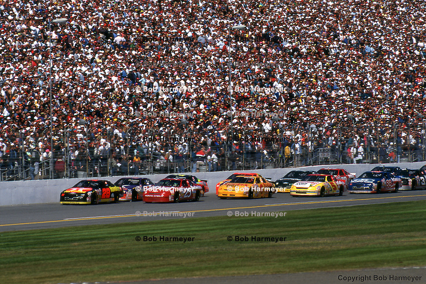 Ernie Irvan leads the field during the 1996 Daytona 500 NASCAR Winston Cup race at Daytona International Speedway.
