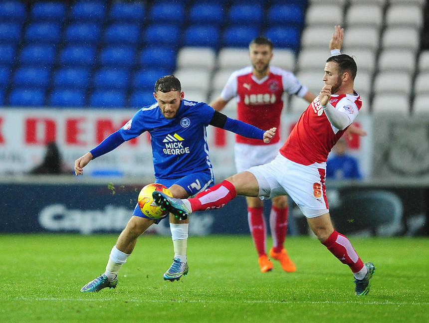 Fleetwood Town's Jimmy Ryan vies for possession with Peterborough United's Jon Taylor<br /> <br /> Photographer Chris Vaughan/CameraSport<br /> <br /> Football - The Football League Sky Bet League One - Peterborough United v Fleetwood Town - Saturday 14th November 2015 - ABAX Stadium - Peterborough<br /> <br /> &copy; CameraSport - 43 Linden Ave. Countesthorpe. Leicester. England. LE8 5PG - Tel: +44 (0) 116 277 4147 - admin@camerasport.com - www.camerasport.com