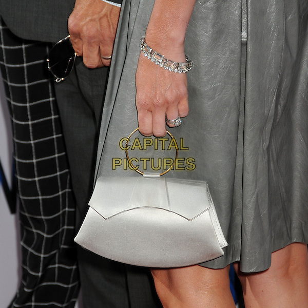 Calista Flockhart's bag <br /> &quot;Paranoia&quot; Los Angeles Premiere held at the Directors Guild of America, West Hollywood, California, USA, 8th August 2013.<br /> silver handbag circle ring handle hand ring bracelet <br /> CAP/ADM/BP<br /> &copy;Byron Purvis/AdMedia/Capital Pictures
