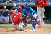 Toronto Blue Jays catcher Jesus Lopez (25) tags Wilfredo Flores (2) out at home during an Instructional League game against the Philadelphia Phillies on September 23, 2019 at Spectrum Field in Clearwater, Florida.  (Mike Janes/Four Seam Images)