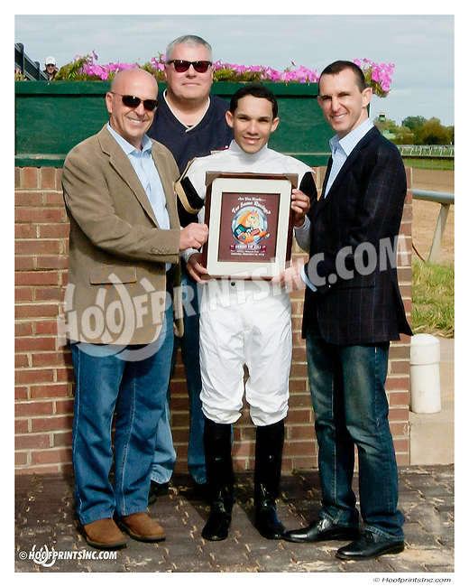Phil DeCosmo accepting The 2013 Owner's Day commemorative print from Ramon Dominguez for Cytherean's win with Joshua Navarro aboard at Delaware Park on 9/14/13