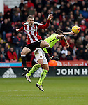 Paul Coutts of Sheffield United tussles in the air with Marc Richards of Northampton Town during the English Football League One match at Bramall Lane, Sheffield. Picture date: December 31st, 2016. Pic Jamie Tyerman/Sportimage