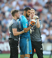 Wolverhampton Wanderers' Rui Patricio receives treatment<br /> <br /> Photographer Rob Newell/CameraSport<br /> <br /> The Premier League - West Ham United v Wolverhampton Wanderers - Saturday 1st September 2018 - London Stadium - London<br /> <br /> World Copyright © 2019 CameraSport. All rights reserved. 43 Linden Ave. Countesthorpe. Leicester. England. LE8 5PG - Tel: +44 (0) 116 277 4147 - admin@camerasport.com - www.camerasport.com