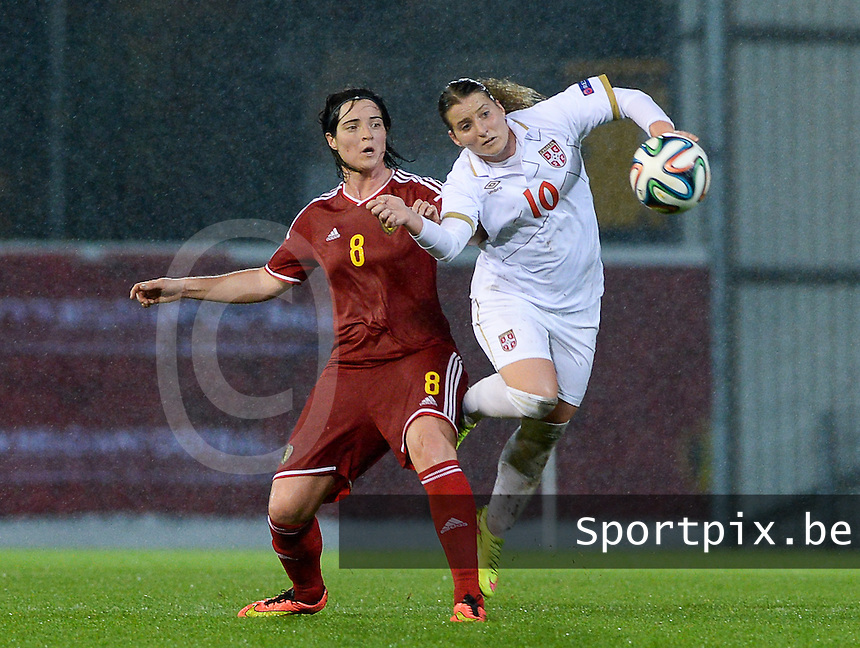 20151130 - LEUVEN ,  BELGIUM : Belgian Cecile De Gernier (left) pictured in a duel with Serbian Jelena Cankovic (r) during the female soccer game between the Belgian Red Flames and Serbia , the third game in the qualification for the European Championship in The Netherlands 2017  , Monday 30 November 2015 at Stadion Den Dreef  in Leuven , Belgium. PHOTO DAVID CATRY