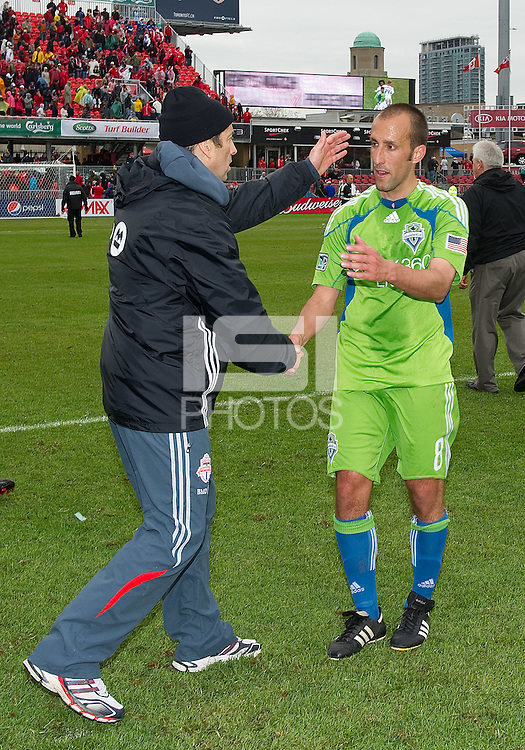 25 April 2010: Toronto FC head coach Preki shows his appreciation to Seattle Sounders midfielder Peter Vagenas #8 at the conclusion of a game between the Seattle Sounders and Toronto FC at BMO Field in Toronto..Toronto FC won 2-0....