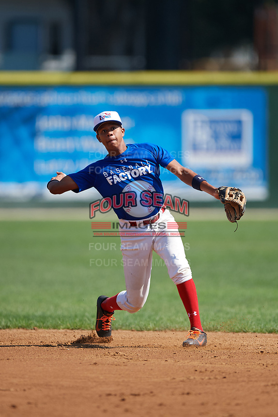 Yeison Lemos (2) warms up during the Dominican Prospect League Elite Underclass International Series, powered by Baseball Factory, on July 31, 2017 at Silver Cross Field in Joliet, Illinois.  (Mike Janes/Four Seam Images)
