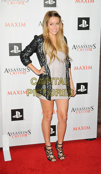 """LAUREN CONRAD .arriving at the Launch Party for """"Assassin's Creed II"""" at Voyeur in West Hollywood, California, USA,.November 11th, 2009..full length dress hand on hip silver sequined sequin jacket strappy sandals grey gray mini open toe .CAP/ROT.©Lee Roth/Capital Pictures"""