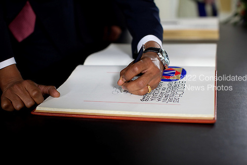 Buchenwald, Germany - June 5, 2009 -- United States President Barack Obama signs a guestbook before touring Buchenwald Concentration Camp in Germany with Chancellor Angela Merkel of Germany and Holocaust survivor Elie Weisel, Firday, June 5, 2009.  .Mandatory Credit: Pete Souza - White House via CNP