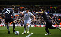 Leeds United's Jack Harrison takes on Sheffield Wednesday's Adam Reach and Liam Palmer<br /> <br /> Photographer Alex Dodd/CameraSport<br /> <br /> The EFL Sky Bet Championship - Leeds United v Sheffield Wednesday - Saturday 13th April 2019 - Elland Road - Leeds<br /> <br /> World Copyright © 2019 CameraSport. All rights reserved. 43 Linden Ave. Countesthorpe. Leicester. England. LE8 5PG - Tel: +44 (0) 116 277 4147 - admin@camerasport.com - www.camerasport.com