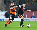 Dundee Utd's Paul Paton and Killie's Alexei Eremenko challenge for the ball.