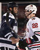Anthony Wyse (UNH - 21), Tanner Pond (NU - 22) - The Northeastern University Huskies and University of New Hampshire Wildcats tied 2-2 on Saturday, January 14, 2017, at Fenway Park in Boston, Massachusetts.