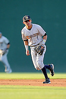 Shortstop Angel Aguilar (7) of the Charleston RiverDogs follows a grounder in a game against the Greenville Drive on Sunday, May 24, 2015, at Fluor Field at the West End in Greenville, South Carolina. Charleston won 3-2. (Tom Priddy/Four Seam Images)